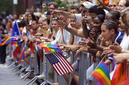 Spectators with flags along the route of the Gay Pride Parade in New York ...